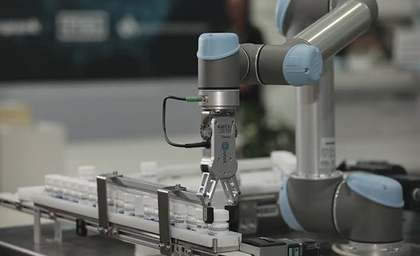 A Collaborative Robotic Arm Holding A Capsules In Pharmaceautical Industry.